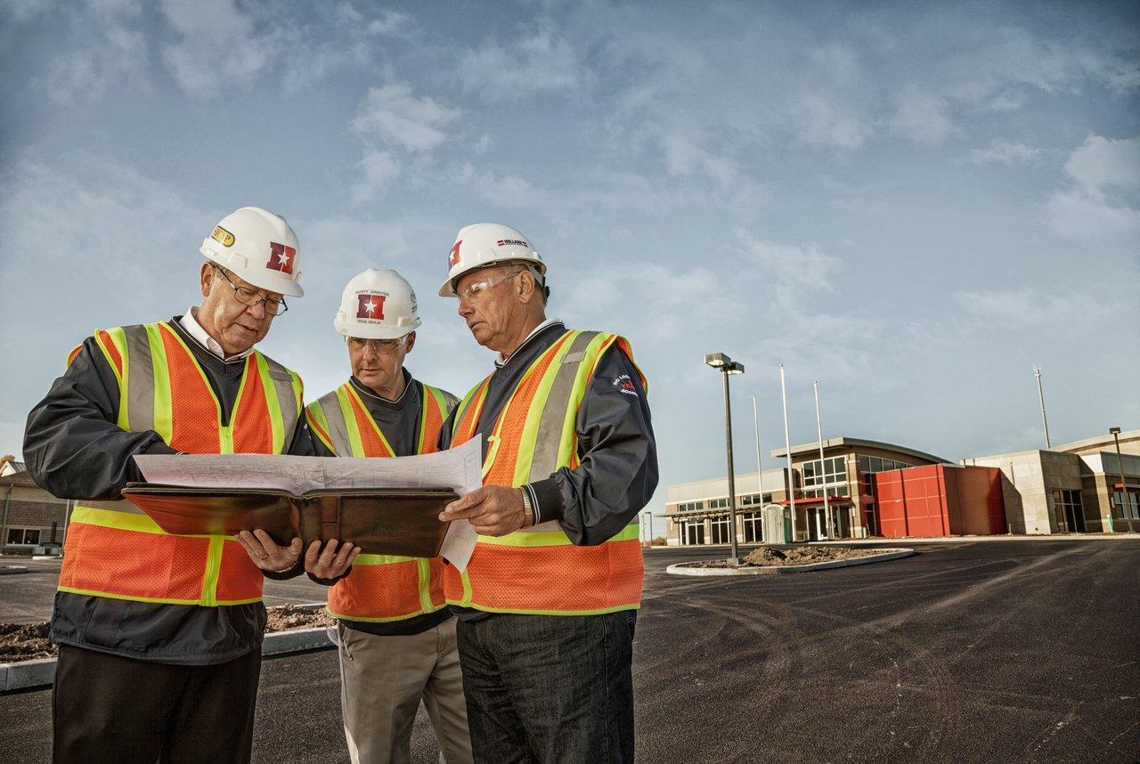men-looking-at-construction-blueprints