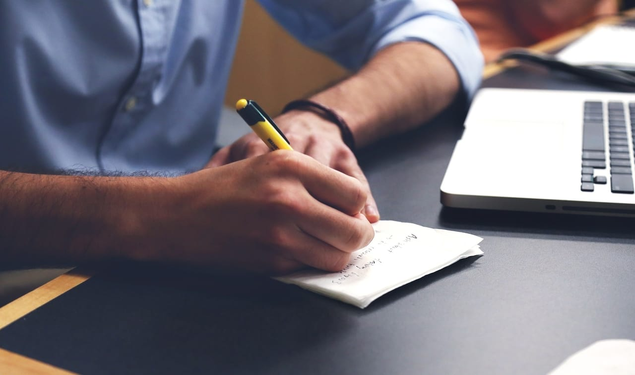 man-writing-note